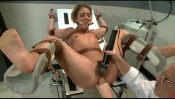 MILF tied up and fisted by a doctor